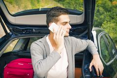 Man with mobile phone in the car. Young man with mobile phone in the car Stock Photo