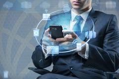 The man with mobile phone in cloud computing concept Stock Photos