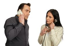 Man with a mobile phone communicates with woman with a vintage p Royalty Free Stock Photography
