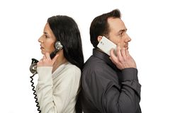 Man with a mobile phone communicates with woman with a vintage p Stock Photo