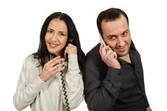 Man with a mobile phone communicates with woman with a vintage p Royalty Free Stock Photo