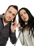 Man with a mobile phone communicates with woman with a vintage p Royalty Free Stock Photos