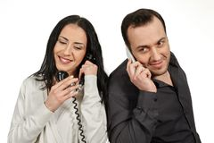 Man with a mobile phone communicates with woman with a vintage p Stock Image