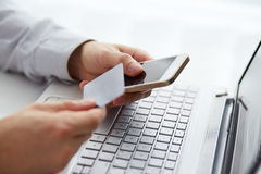 Man with mobile phone and credit card payment Stock Image