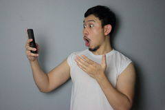 A man and mobile phone. A man get good news from mobile phone royalty free stock photo