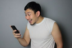 A man and mobile phone. A man get good news from mobile phone stock photos
