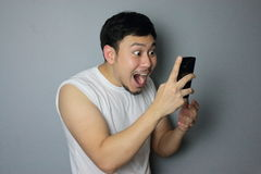 A man and mobile phone. A man get good news from mobile phone royalty free stock photos