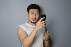 A man and mobile phone. A man get good news from mobile phone stock photography