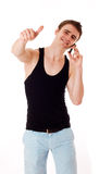 Man with mobile phone giving a thumbs up. Stock Photos