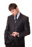 Man with a mobile phone in hand. Young man with a mobile phone in hand Royalty Free Stock Images