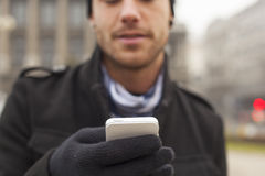 Man with mobile phone in hands Royalty Free Stock Photos