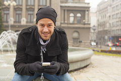 Man With Mobile Phone And Hat In City, Urban Space Stock Photography