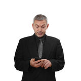 Man with mobile phone. Middle age man dressed in business black suit with mobile phone in hands isolated on white background royalty free stock photos