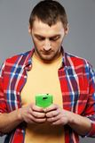 Man with a mobile phone Stock Photography