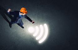 Man with mobile phone. Top view of businessman in hardhat using mobile phone Royalty Free Stock Photography