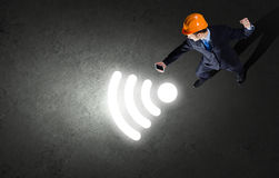 Man with mobile phone. Top view of businessman in hardhat using mobile phone Royalty Free Stock Images
