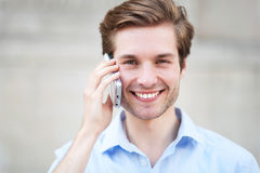 Man with mobile phone. Young man with mobile phone Royalty Free Stock Images