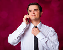 Man with mobilephone. On red background Stock Photography