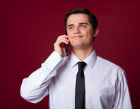 Man with mobilephone. On red background Stock Images