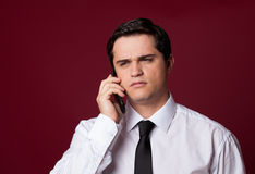 Man with mobilephone. On red background Stock Photo