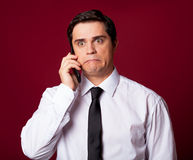 Man with mobilephone. On red background Royalty Free Stock Photo