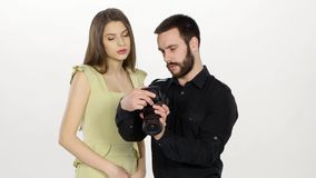 Man and model are look the result of shooting. White stock video