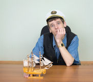 Man with model of a sailing vessel. Man with wooden model of a sailing vessel Royalty Free Stock Photography