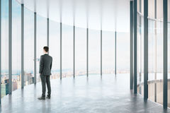 Man in modern glass corridor Royalty Free Stock Photography