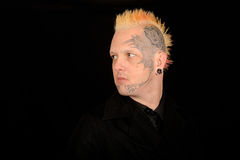 Man with Mohawk. Hairstyle and facial tattoos Stock Photo