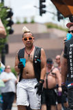 A man with a mohawk walks in Gay Pride Parade. Taken in Des Moines, Iowa during gay pride parade Royalty Free Stock Photography