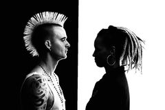 Man with Mohawk and Woman with Dreadlocks. Caucasian Man with Mohawk and African-American Woman with Dreadlocks Royalty Free Stock Photography