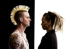 Man with Mohawk and Woman with Dreadlocks. Caucasian Man with Mohawk and African-American Woman with Dreadlocks Stock Photo