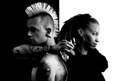 Man with Mohawk and Woman with Dreadlocks. Caucasian Man with Mohawk and African-American Woman with Dreadlocks Stock Photos
