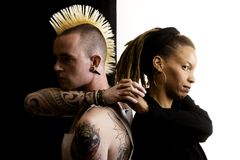 Man with Mohawk and Woman with Dreadlocks Stock Photography