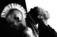 Man with Mohawk and Woman with Dreadlocks Stock Photos