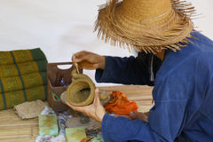 Man molding elephant clay figurine Stock Photography