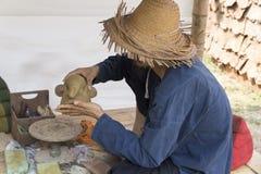 Man molding elephant clay figurine Royalty Free Stock Image