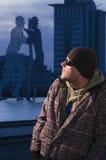man by the Molekular Man sculpture Stock Photos
