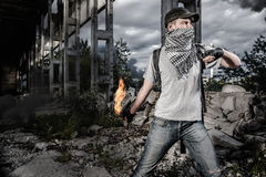Man with Molotov cocktail Royalty Free Stock Images