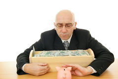 Man with money. Man and piggy near trough on white background Stock Photography