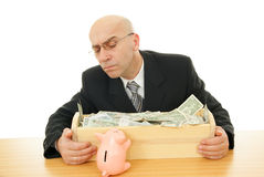 Man with money. Man and piggy near trough on white background Royalty Free Stock Image