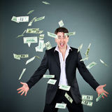 Man and money. Man in a suit throws money royalty free stock image