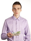 Man with money. Young casual man with some international money Royalty Free Stock Photos