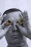 Man with money as binoculars Stock Images