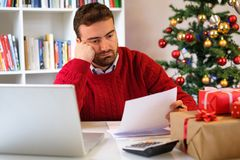 Man without money for christmas present. Man tapped out and without money for christmas gifts Stock Image