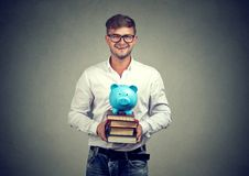 Man with money for education royalty free stock photography