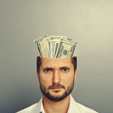 Man with money in the head Stock Images