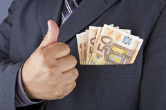 Man with money in his pocket Royalty Free Stock Photo