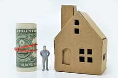 Man with money and home. Wealth concept Royalty Free Stock Image