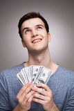 Man with money looking up Royalty Free Stock Images